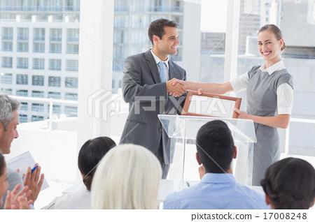 Stock Photo: Business people receiving award