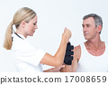 Doctor examining a man wrist 17008659