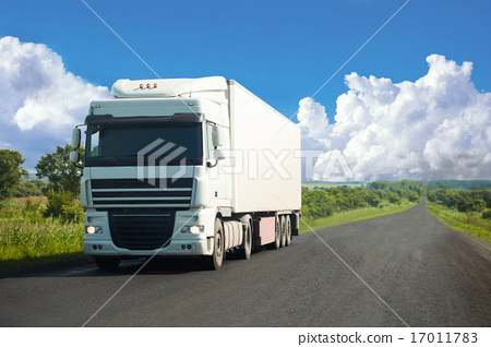 White truck moving on a road 17011783