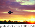 Skydiver On Colorful Parachute In Sunny Sky 17013858