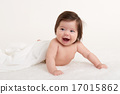 happy baby under towel on white 17015862