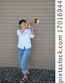 Female trumpet player. 17016944