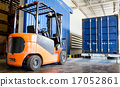 Forklift in warehouse with container 17052861