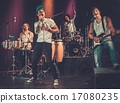 Multiracial music band performing on a stage 17080235