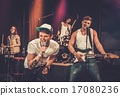 Multiracial music band performing on a stage 17080236