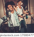 Multiracial music band performing in a recording studio 17080477