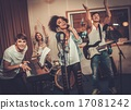 Multiracial music band performing in a recording studio 17081242