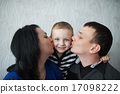mom and dad kiss son 17098222