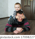 boy father lying on the floor at home 17098227