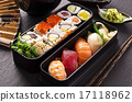 bento box with sushi and rolls 17118962