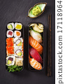 bento box with sushi and rolls 17118964