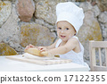 little boy with chef hat cooking 17122355