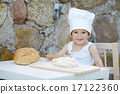 little boy with chef hat cooking 17122360