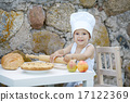 little boy with chef hat cooking 17122369