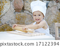 little boy with chef hat cooking 17122394