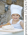 little boy with chef hat cooking 17122417