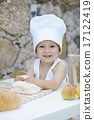 little boy with chef hat cooking 17122419