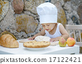 little boy with chef hat cooking 17122421