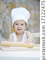 little boy with chef hat cooking 17122475