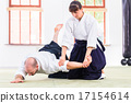 Man and woman fighting at martial arts school 17154614