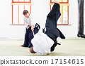 Man and woman having Aikido stick fight 17154615