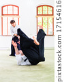 Man and woman having Aikido stick fight 17154616