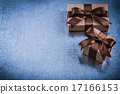Copyspace of gift boxes with brown bows holidays concept 17166153