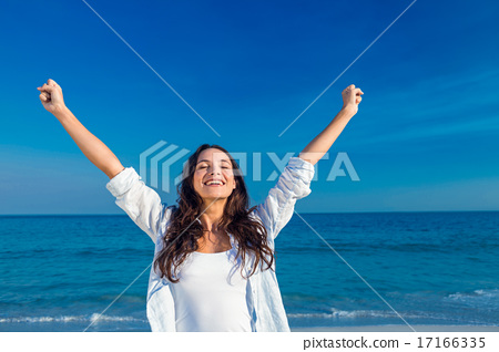 Stock Photo: Happy woman smiling at the beach