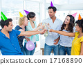 Casual business team toasting with champagne 17168890