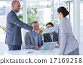 Interview panel shaking hands with applicant 17169258