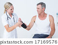 Doctor examining a man wrist 17169576