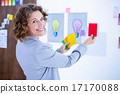 Creative businesswoman holding color cards and looking at camera 17170088