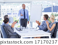 Business people applauding during meeting 17170237