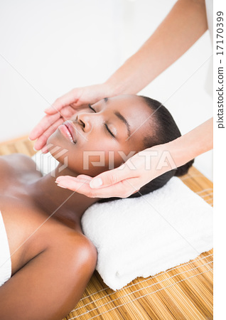 Pretty woman enjoying a head massage 17170399