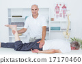 Physiotherapist doing leg massage to his patient 17170460