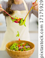 Closeup on housewife mixing vegetable salad 17175929