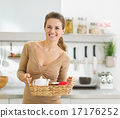 Smiling young housewife with breakfast tray 17176252