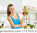 Happy young woman holding bunch of radishes 17176313