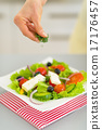 Closeup on young housewife serving salad 17176457