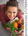 Portrait of happy young housewife with shopping bag of fresh veg 17176884