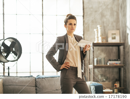 Business woman with tablet pc in loft apartment 17178190