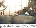 Closeup on young woman sitting with tablet pc in loft apartment 17178256