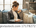 Business woman drinking coffee latte in loft apartment 17178272