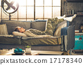 Relaxed young woman laying in loft apartment 17178340