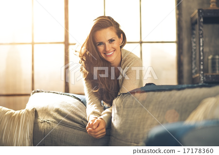 Portrait of happy young woman in loft apartment 17178360