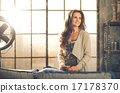 Casual brunette with coffee smiling in loft apartment 17178370