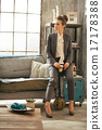 Full length portrait of business woman with coffee latte in loft 17178388