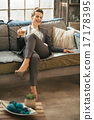 Happy business woman with coffee latte in loft apartment 17178395