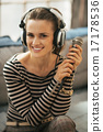 Portrait of happy young woman with headphones and microphone 17178536