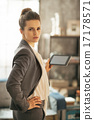 Portrait of business woman using tablet pc in loft apartment 17178571